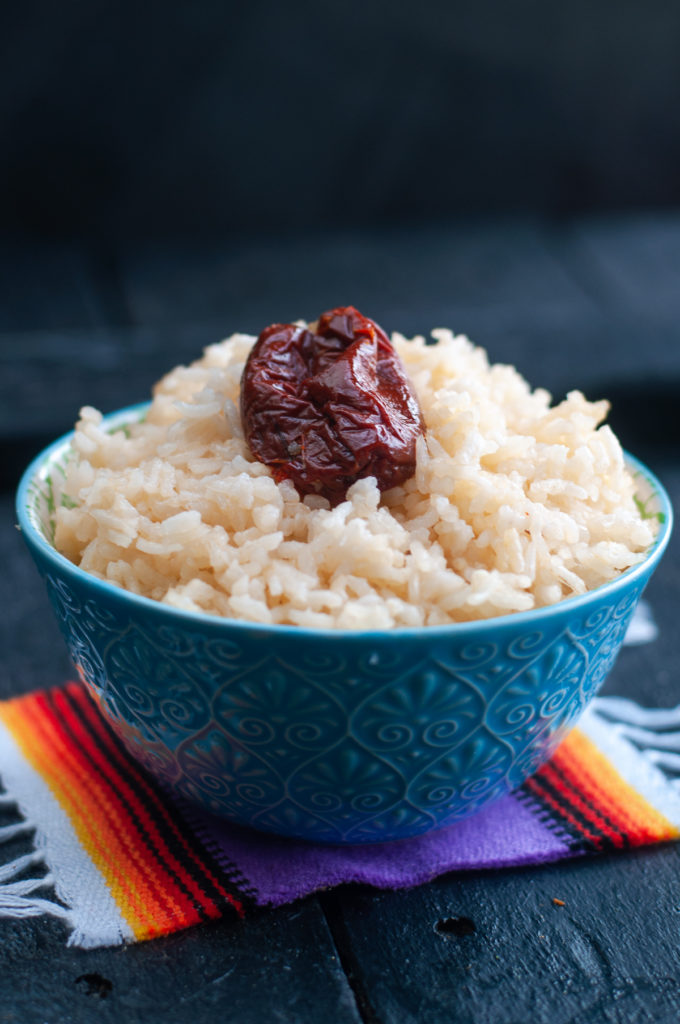 Chipotle White Rice takes basic white rice and elevates it by adding in a whole chipotle pepper. It adds a nice spiciness to the rice. A Perfect side dish.