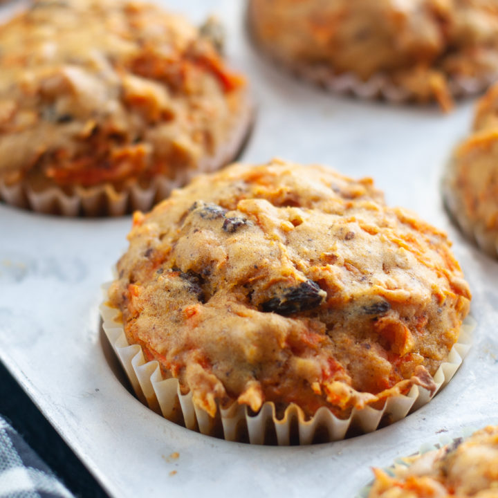Muffins are a great way to start the morning! These muffins are loaded with carrots, raisins and walnuts! #muffins #breakfast #recipe #carrots