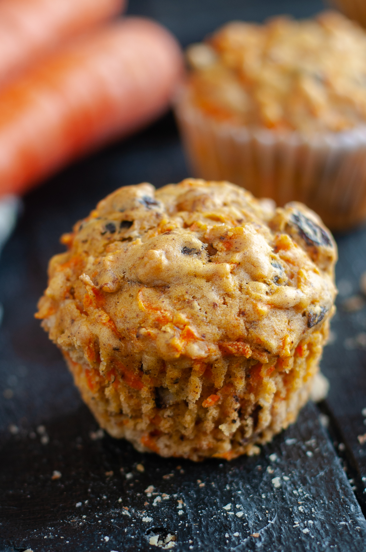 muffins are loaded with shredded carrots, raisins and walnuts add nutty crunch. Perfect served alongside your morning coffee. #vegan #muffin #breakfast #recipe #carrot #spring #easter