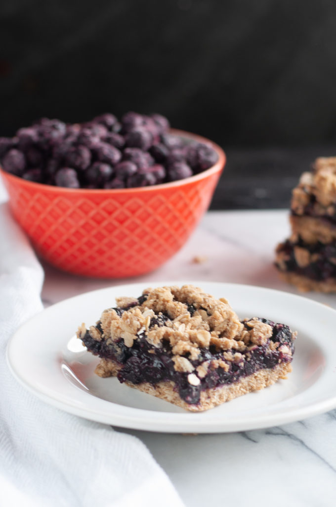 Vegan Blueberry Pie Bars have all the flavors of traditional blueberry pie, but in bar form! A great dessert or sweet breakfast! #vegan #dessert #blueberries #dairyfree #glutenfree #good #pie #fruit #snack