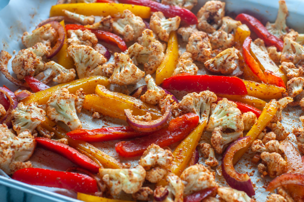 Looking for a quick and easy dinner recipe? You're going to love how easy it is to make these Vegan Sheet Pan Cauliflower Fajitas!