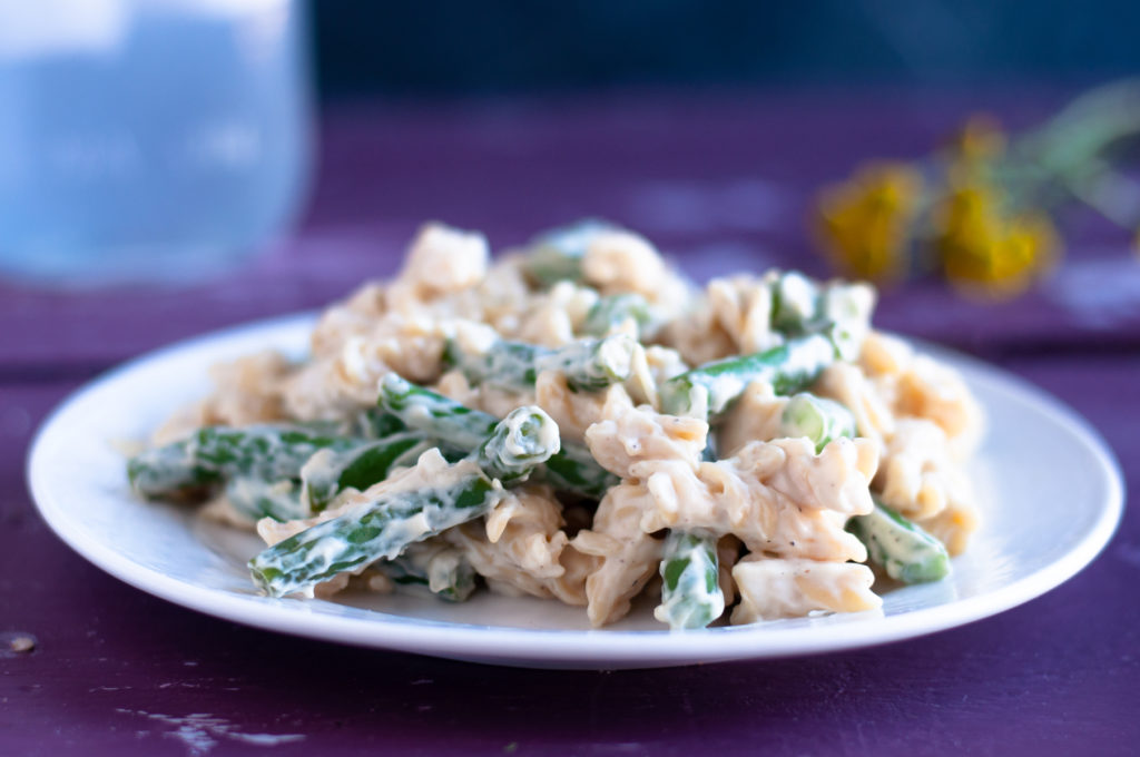 This rich creamy green bean pasta takes less than 30 minutes to cook! Perfect for when you're craving something a little more decedent for dinner. It's dairy-free too! #vegan #pasta #recipe #dinner #dairyfree #veganrecipes #glutenfree #greenbean