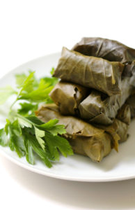 A Mediterranean classic made vegan and gluten-free. Rice stuffed dolmades full of fresh herbs, roasted eggplant, olives, spices, and aromatic basmati rice! A fantastic appetizer, side, or main dish!
