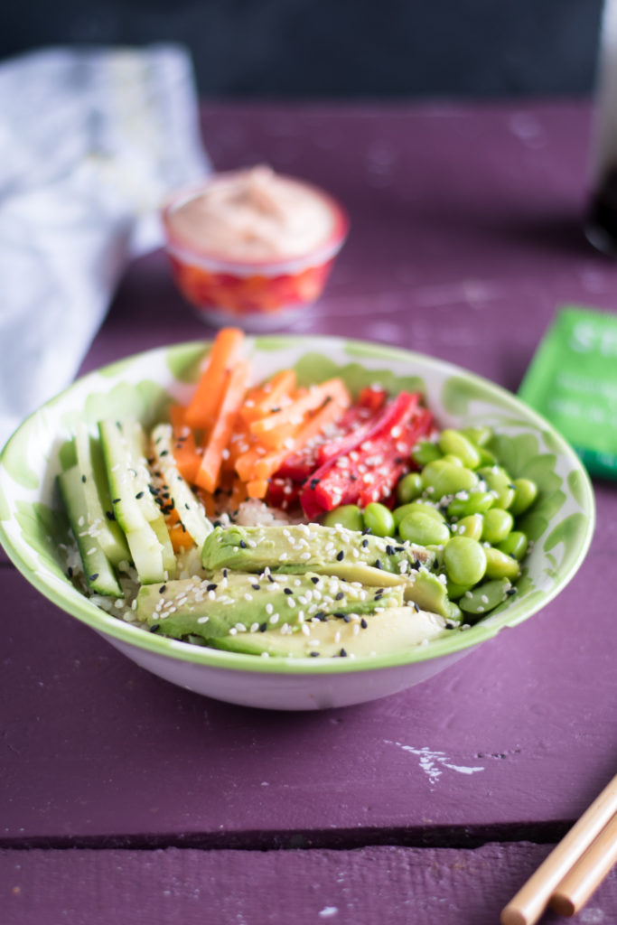 Vegan Sushi Bowl with Green Tea Rice is a healthy plant-based vegan bowl topped with lots of fresh vegetables. The green tea adds an earthy, herbaceous note to the rice.