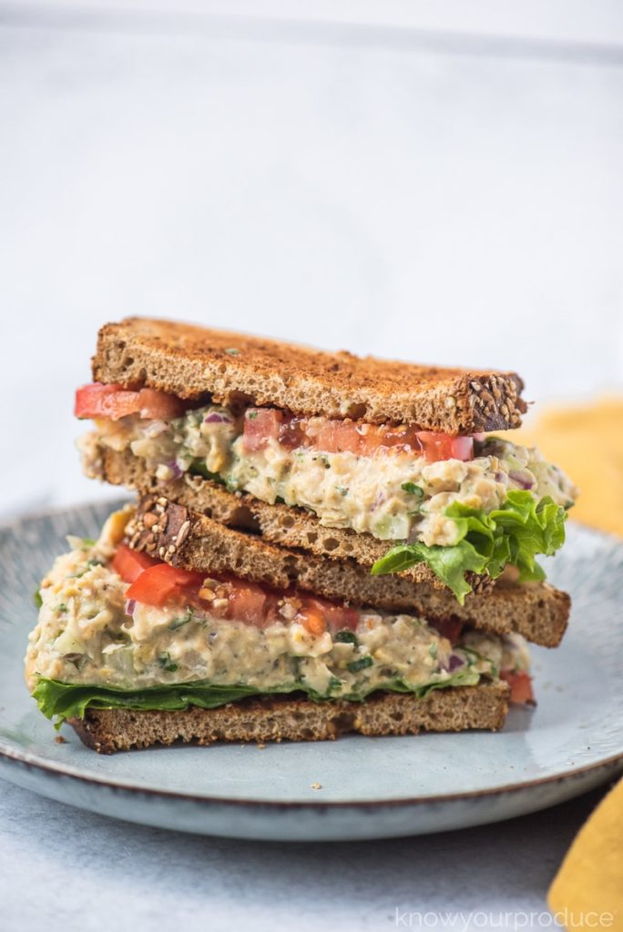 Vegan Tuna Salad filled with chickpeas, celery, onions, fresh herbs, kelp flakes, and even flaxseed for omega 3. It makes the best chickpea salad sandwich and it's perfect for breakfast lunch or dinner.