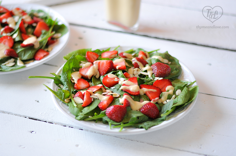The salad base couldn't be simpler: fresh spinach, sweet floral strawberries, and toasted almonds. When you taste the rhubarb dressing with the strawberries, the flavors will just sing.