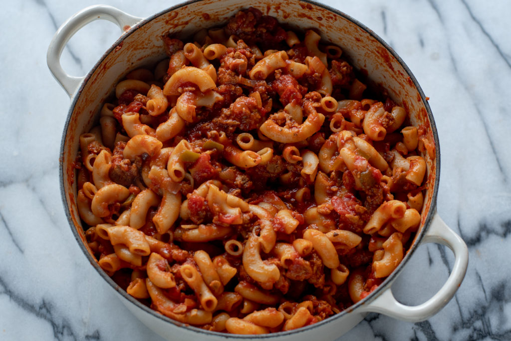 American Goulash is a comforting pasta dish made with elbow noodles, canned tomatoes, and usually ground beef. It makes a ton and the leftovers taste great!