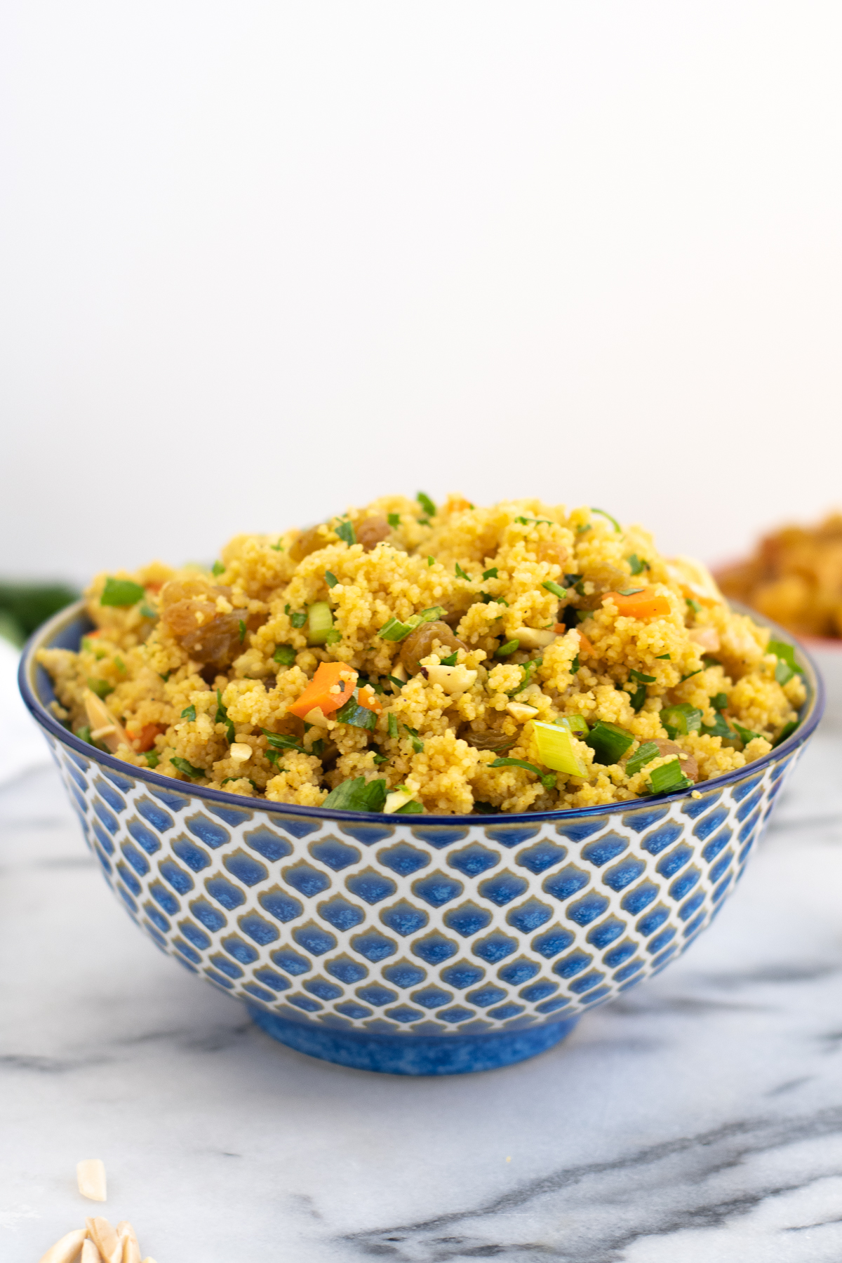 Quick to prepare, this Curried Couscous is a healthy side dish that is full of flavor and textures! #side #couscous #curry #easyrecipe #recipe #vegan