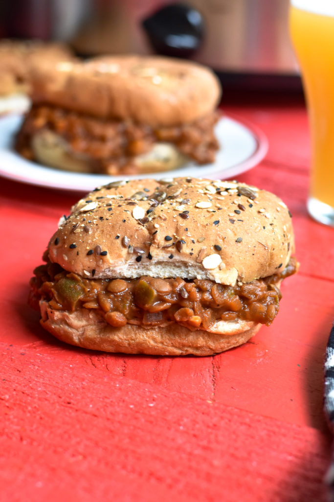 This recipe for Lentil Sloppy Joes couldn't be easier to make. The slow cooker does all the work for you, making this recipe perfect for an easy dinner. This plant-based spin on the classic sloppy joe is a crowd pleaser that won't break the bank! #vegan #vegetarian #sloppyjoes #Lentils #slowcooker #crockpot