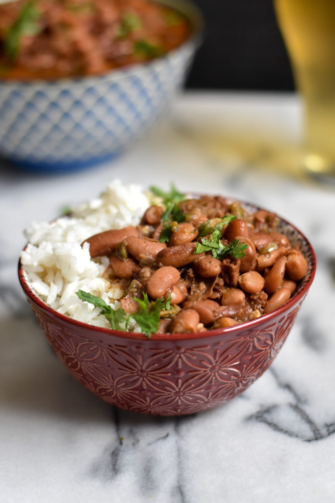 Drunken beans served over rice is a delicious budget-frendly meal that is great for meal prep.