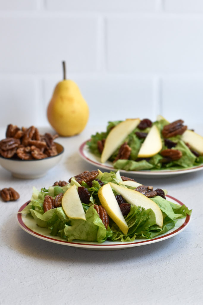 This pear salad with candied pecans and balsamic vinaigrette would be a great addition to your Thanksgiving menu too. I definitely plan on making this salad for my family this Thanksgiving!  #salad #Thanksgiving #pears #pecans #recipes #Christmas