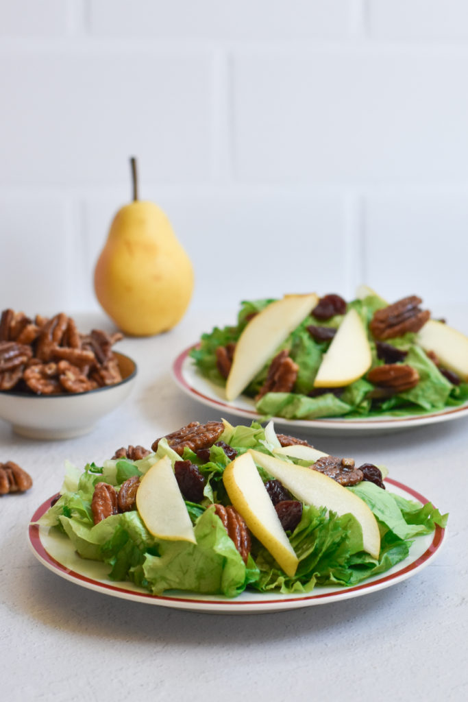This pear salad with candied pecans and balsamic vinaigrette would be a great addition to your Thanksgiving menu too. I definitely plan on making this salad for my family this Thanksgiving!  #salad #recipes #holiday #vegan #pear #dressing #pecans #dairyfree #Christmas #Thanksgiving