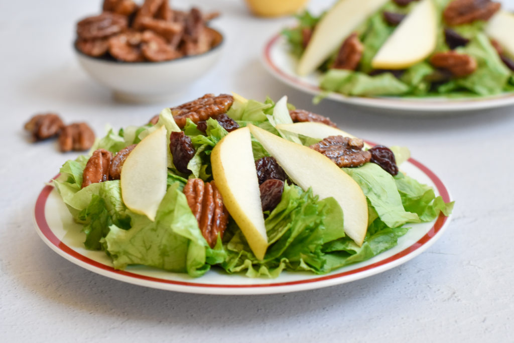 This pear salad with candied pecans and balsamic vinaigrette would be a great addition to your Thanksgiving menu too. I definitely plan on making this salad for my family this Thanksgiving!