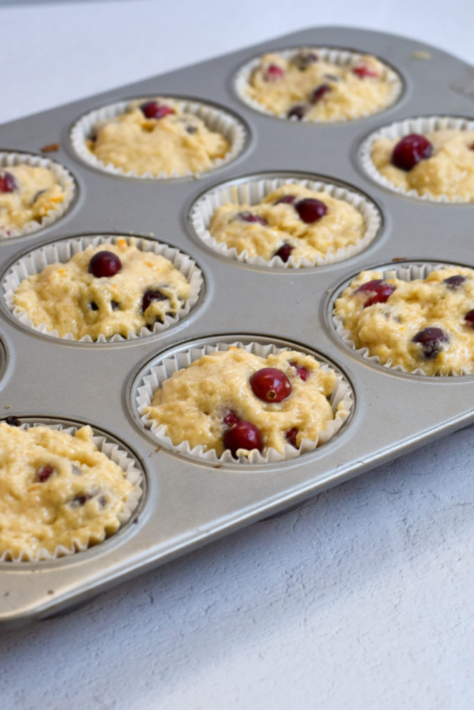 Light, fluffy Vegan Orange Cranberry Muffins are the perfect way to start your day!