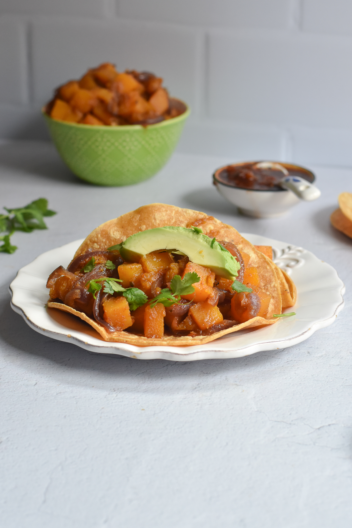Braised Butternut Squash Tacos are a hearty, filling plant-based taco that is perfect for taco night. #vegan #taco #VeganMexican #dinner #recipe #glutenfree