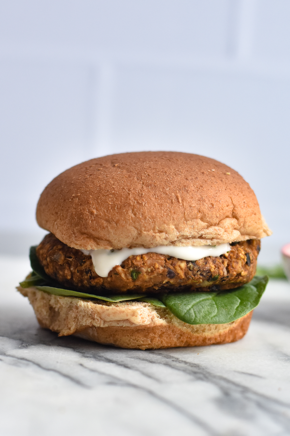 Black beans burgers made with pumpkin, oats and walnuts topped with a cilantro sauce.