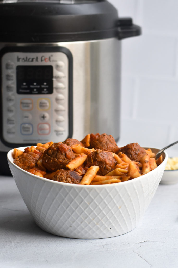 Dinner just got easier with this recipe for Instant Pot Frozen Meatballs with Pasta. Simply add all the ingredients to the Instant Pot and let it do its thing!