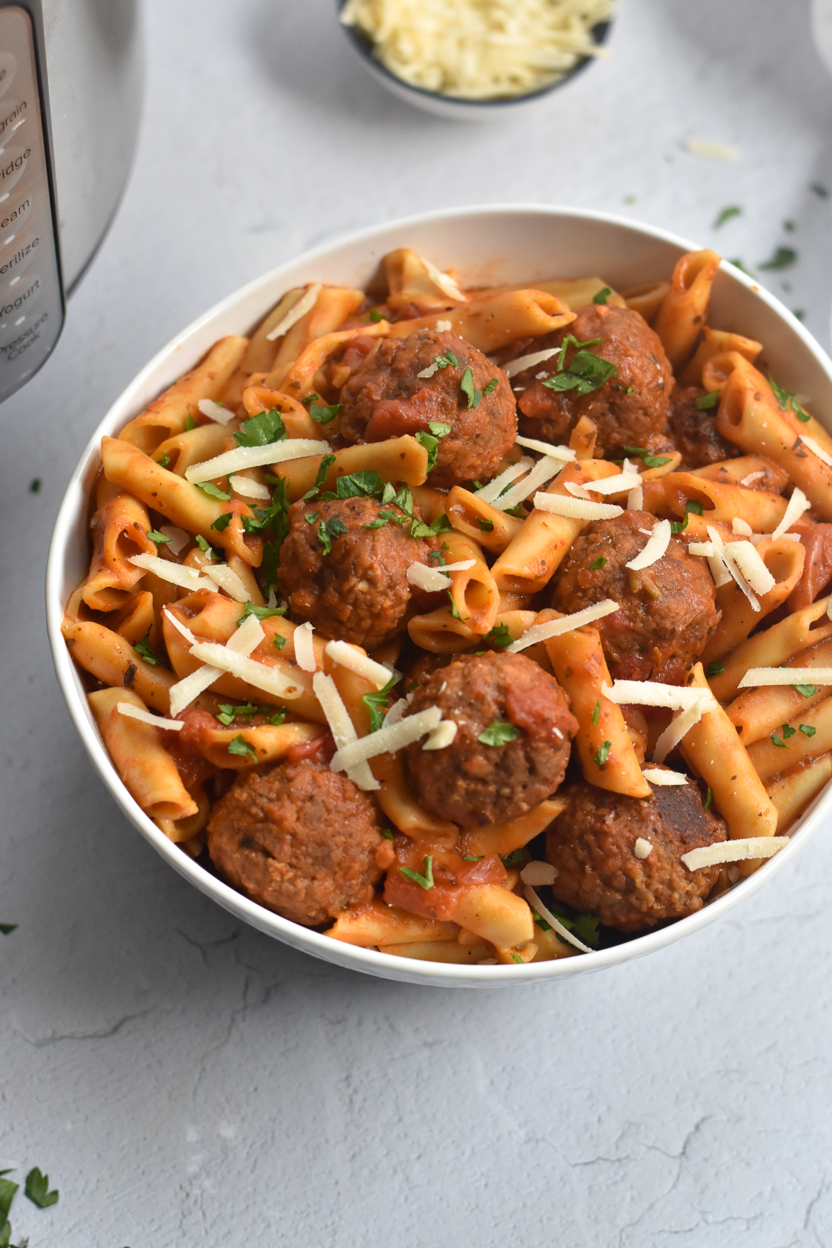 Not sure what to make for dinner? How about pasta with meatballs made right in the Instant Pot! #pasta #easyrecieps #recipe #vegan #meatballs #pantrymeals #vegetarian