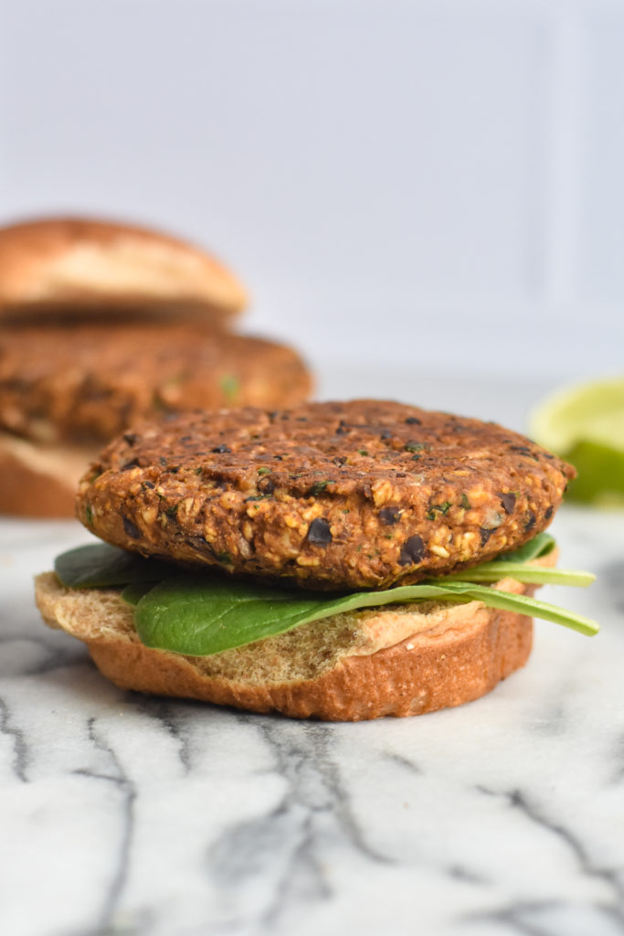 Black bean burgers made with walnuts, pumpkin, and oats. These vegan burgers are easy to make and delicious.
