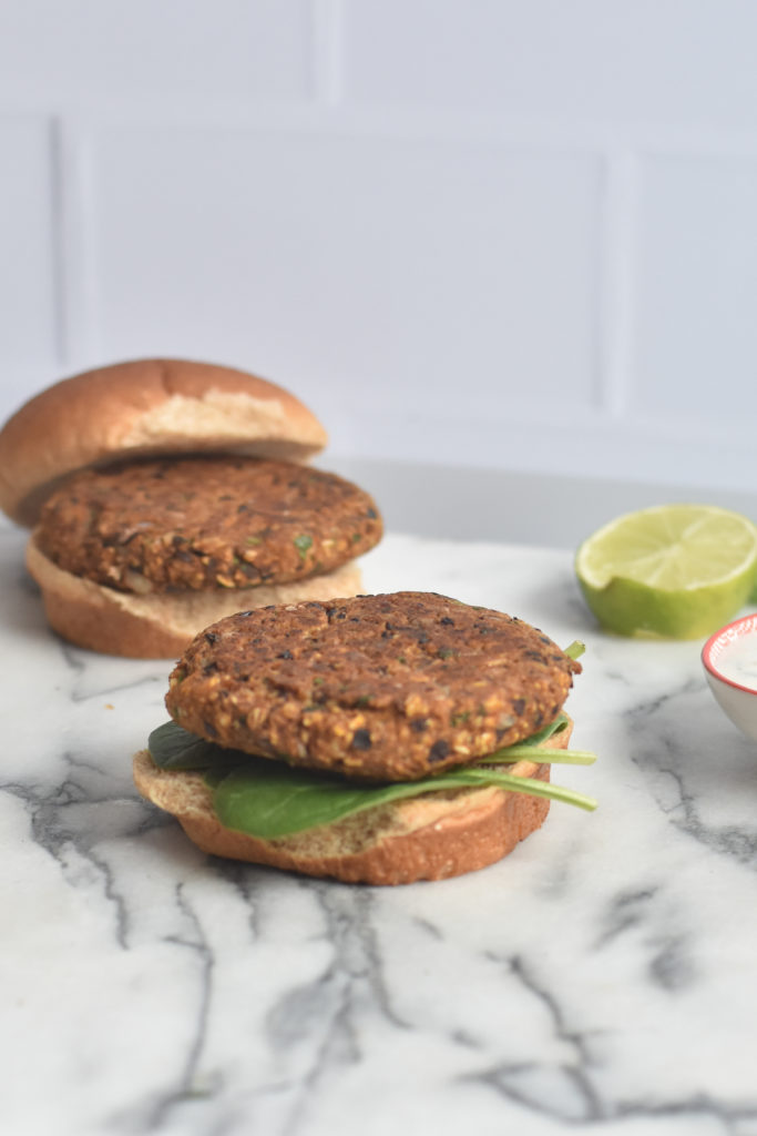 Vegan Pumpkin Black Bean Burgers take less than 30 minutes to make and are protein packed and delicious.