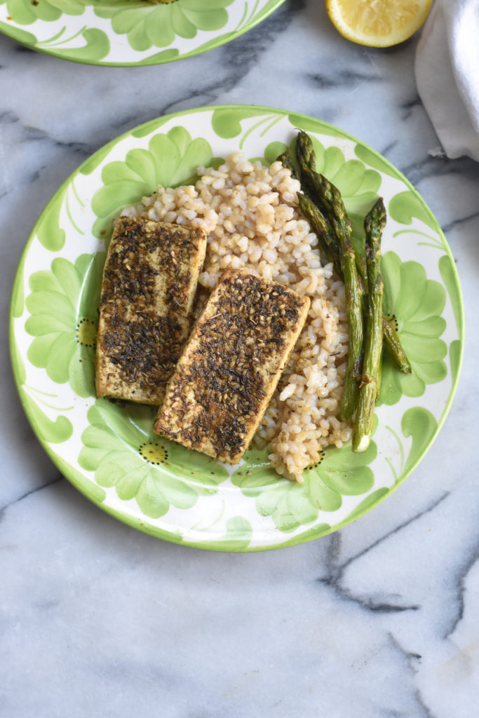 Za'atar Tofu served with rice and asparagus is a light, healthy vegan dinner option.