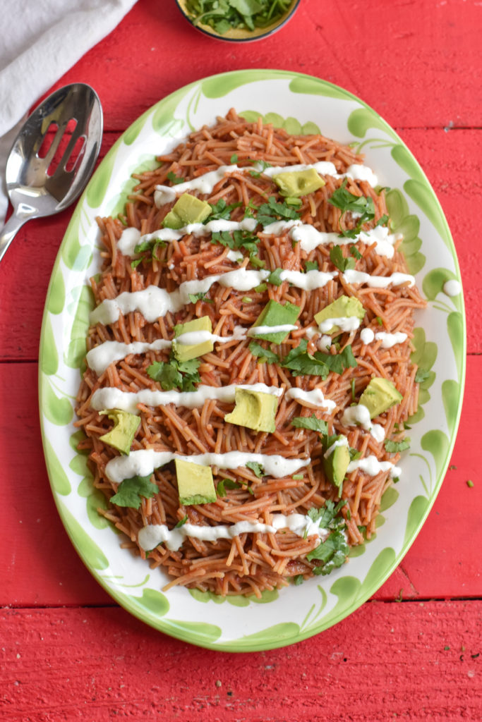 Vegan Mexican Fideo is an easy Mexican pasta recipe that is quick and easy to make. The pasta is topped with dairy-free crema and avocado.