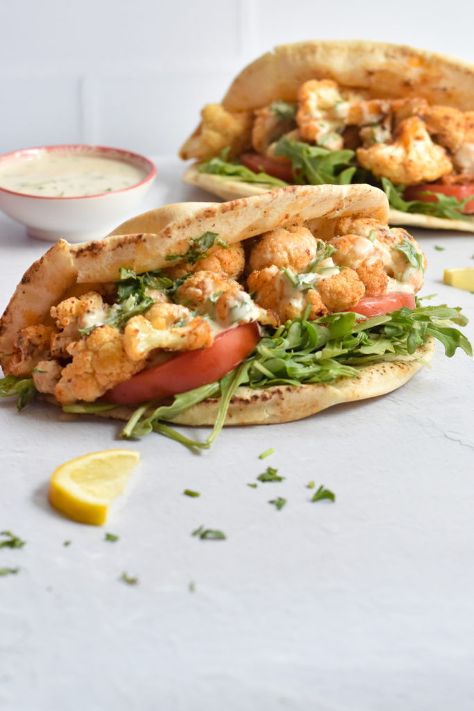You're going to love easy it is to make this healthy, delicious recipe for Roasted Cauliflower Pitas with garlic lemon tahini sauce.