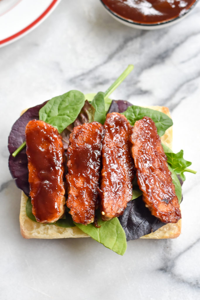 Easy vegan sandwich with BBQ baked tempeh.