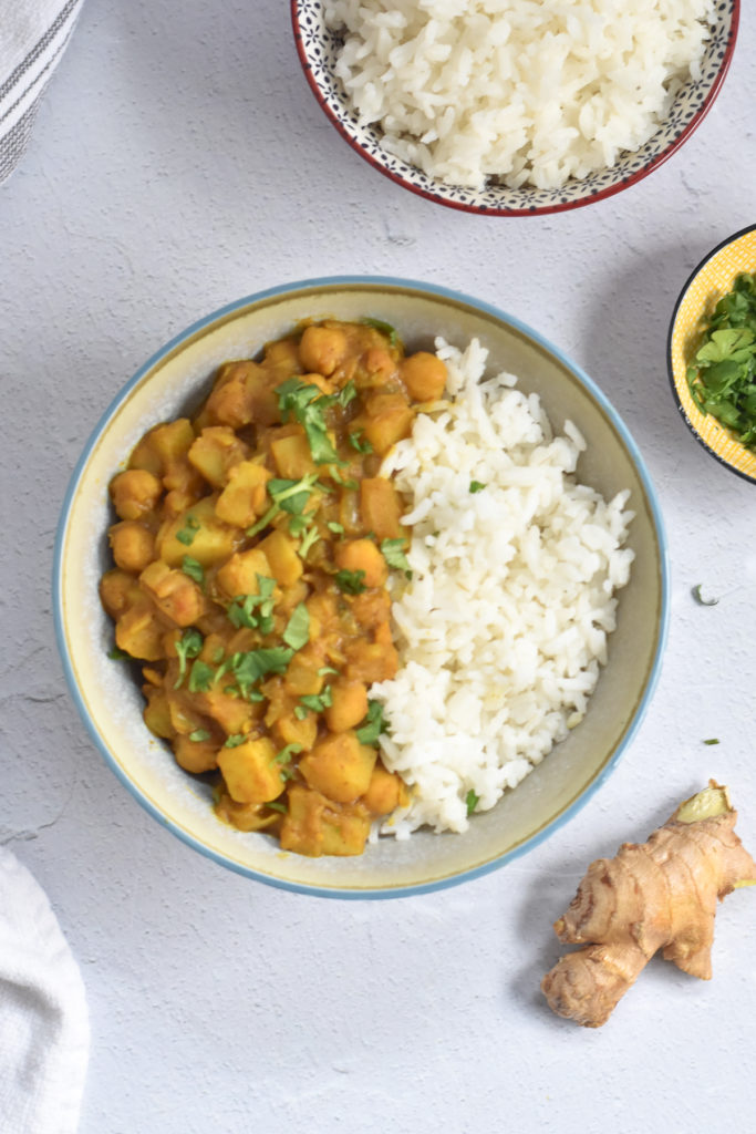 This recipe for Potato Chickpea Curry with mango chutney is a quick and easy plant-based curry recipe. Serve with white rice and naan bread.