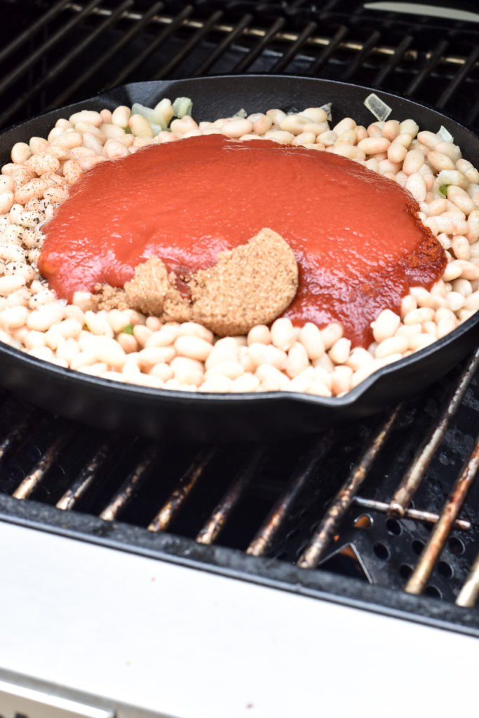 Cooking baked beans on the grill. An easy side dish perfect for summer.