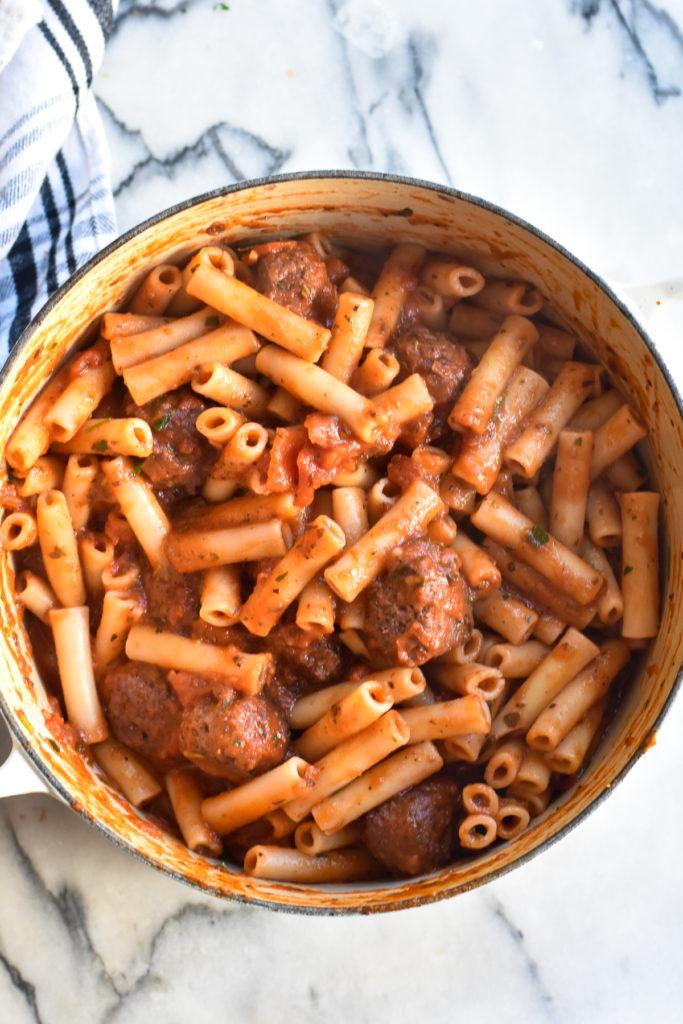 Pasta with marinara sauce and meatballs.