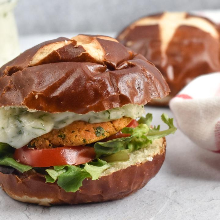 Vegan Chickpea Burgers topped with a vegan tzatziki sauce.