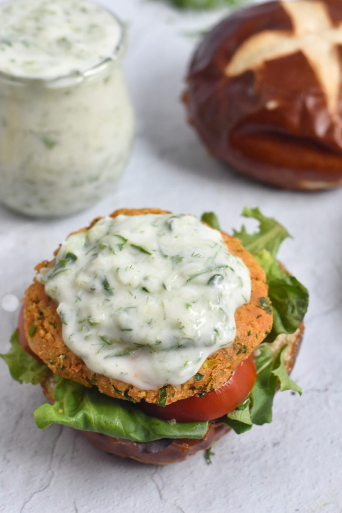 These Vegan Chickpea Burgers with Tzatziki Sauce are made with Middle Eastern spices and fresh herbs.