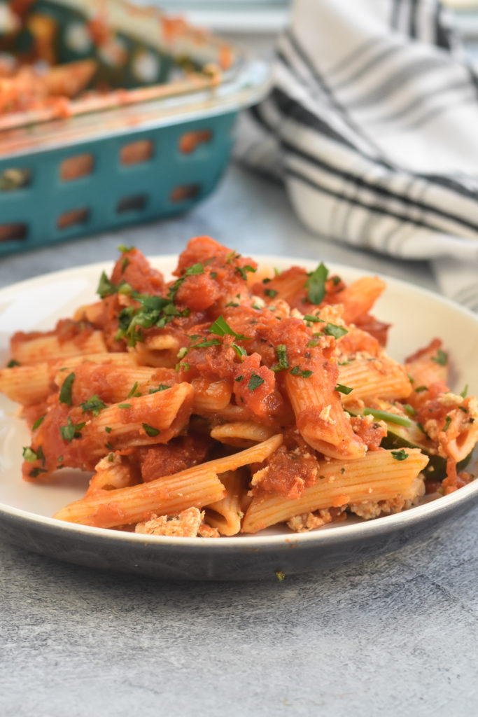 Penne pasta with marinara sauce layered with an easy homemade vegan ricotta recipe and zucchini.