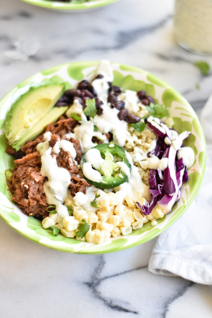 Plant-based BBQ Ranch Jackfruit Bowls are loaded with sweet corn, black beans, cabbage, jalapeños, avocado and a creamy vegan ranch dressing.