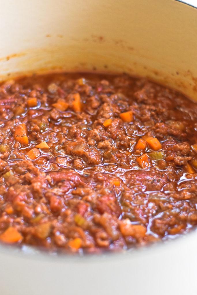 Vegan pasta sauce featuring Impossible Foods Spicy Sausage.